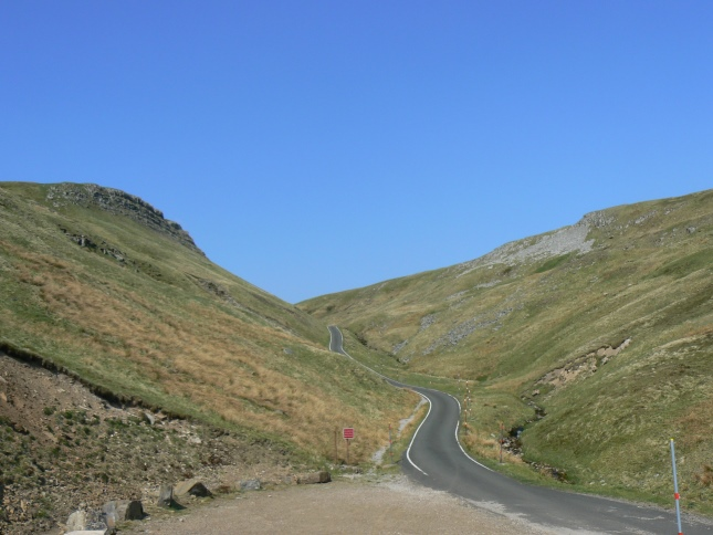 The road leading to the top of Great Dun Fell with the slopes of Knock Fell on the right