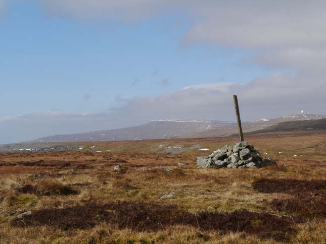 The summit cairn looking towards Cross Fell