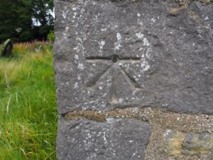 A cut benchmark on the corner of the church