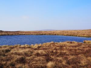 The small tarn to the west of the summit