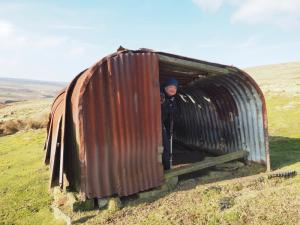 Paul in the strange corrugated shelter we came across