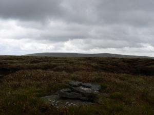 The smaller pile of stones on the summit of Three Pikes