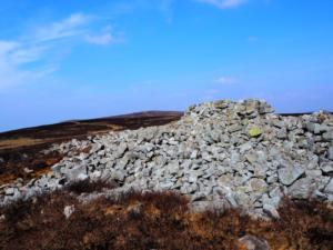 The sprawling cairn at the 439m spot height on the southern end of Cumrew Fell