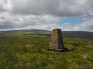 The Staneshaw Rigg trig point with Cross Fell in the distance
