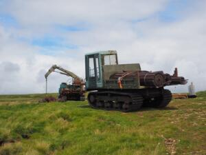A digger with more of the track matting