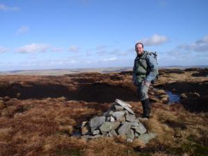 By the summit cairn on Chapelfell Top