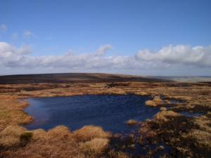 Looking back at Chapelfell Top from a tarn on Fendrith Hill