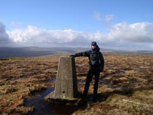 Matt by the trig point on Fendrith Hill