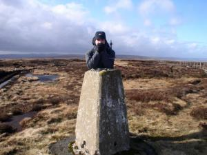 Matt by the trig point on Westernhope Moor
