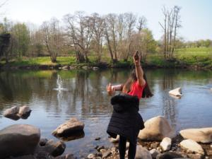 My daughter having fun throwing stones int he river
