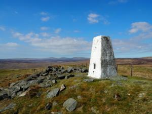 The trig point looking towards Cross Fell and the Dun Fells
