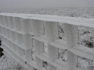 Wind blasted ice on the fence heading to Tom Smith's Stone Top