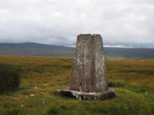 The trig point on Green Hill looking towards Killhope Law