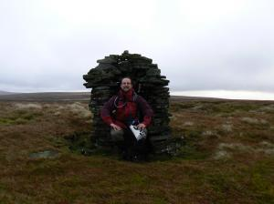 On the seat shaped cairn on the north top of Murton Fell