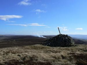 The currick on Killhope Law - heather burning in the background