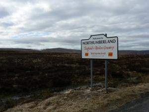 The Northumberland boundary sign - Killhope Law in the distance