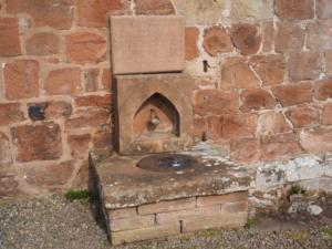 St Oswald's Well under the west wall of the church