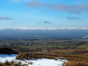 Looking back at the snow-topped fells of Lakeland