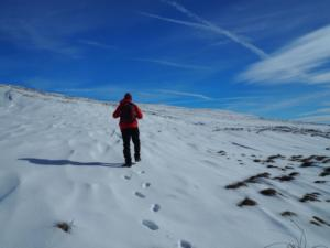 Climbing up over the snow on to the upper reaches of Knock Fell