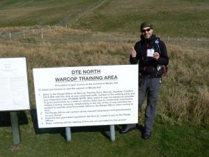 Matt with his permit next to a Warcop Range sign