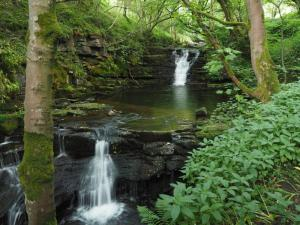 The lovely twin falls at the start of the path alongside Middlehope Burn
