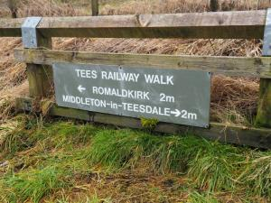 A Tees Railway Walk sign in the cart park