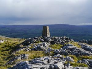 The trig point on Musgrave Scar looking towards Nine Standards Rigg