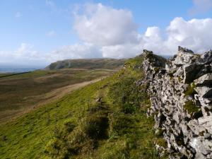 The wall running along the top of White Rigg