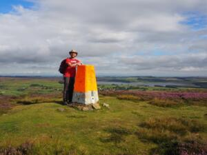 By the brightly coloured trig point on Stoterly Hill