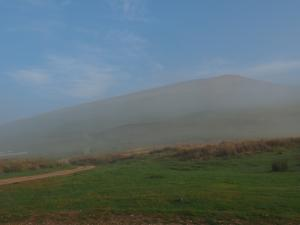 A thin layer of mist slightly obscuring Murton Pike