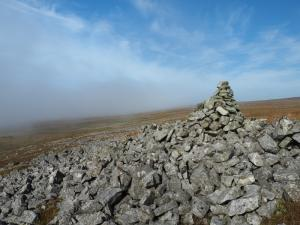 Emerging back out of the cloud to reach the currick on North Edge