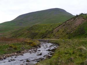 The imposing outline of Roman Fell above Hilton Beck