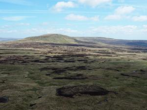 Looking across a sea of peat hags towards Mickle Fell