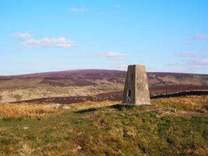 The Kelky Fell trig point looking towards Cold Fell
