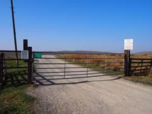 The gate next to the layby at the start of the walk