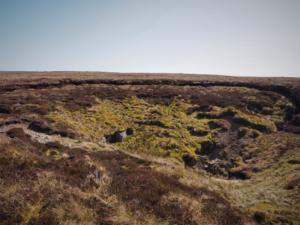 The large shake hole alongside the fence on the way to the top of Bink Moss