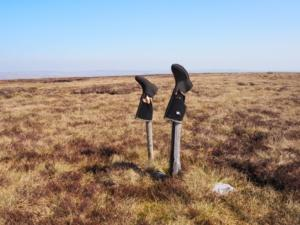 The wellies on stakes marking the top of Bink Moss