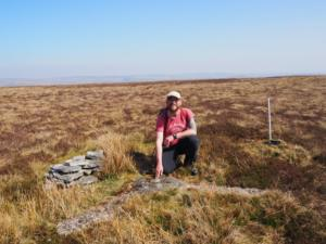 Me alongside the rare 'Curry Stool' trig point on Bink Moss
