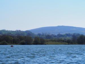 Me and Rhi kayaking on Talkin Tarn with Cumrew Fell in the background