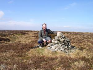 By the summit cairn on The Dodd
