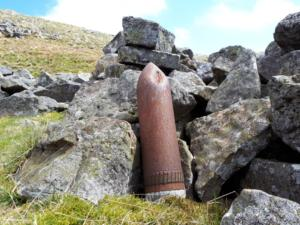A shell propped up by a fold below Tinside Rigg