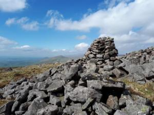 The cairn and shelter on the summit of Roman Fell