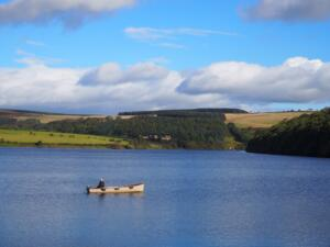 Someone enjoying a bit of boating on Tunstall Reservoir